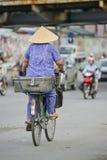 Vietnamese woman on a bike Royalty Free Stock Image