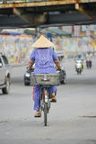 Vietnamese woman on a bike Royalty Free Stock Photos