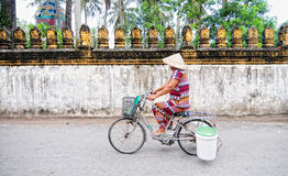 Vietnamese woman biking on street Royalty Free Stock Image