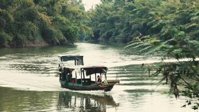 Boat crossing Jungle River stock footage