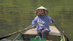 Vietnamese woman boat guide is ready to sail stock video footage