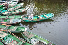 Vietnamese woman in a boat on the river. Ninh Binh. Vietnam Stock Photography