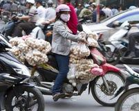 Vietnamese woman carting eggs in Hanoi. Vietnamese woman carting eggs on a motorbike stock photo