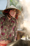 Vietnamese woman cooking Stock Photography