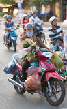 Vietnamese woman drives her purchasing Stock Photos
