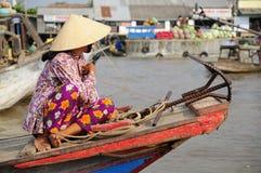 Vietnamese Woman at a Morning Floating Market Stock Image
