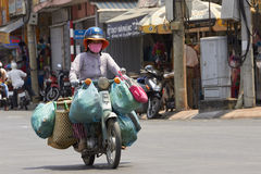 Vietnamese woman on motorbike Royalty Free Stock Photography
