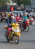 Vietnamese woman motorcyclist drives sacks Stock Images