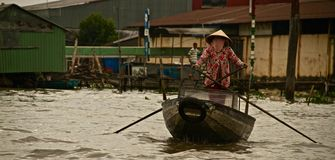 Vietnamese woman paddling on the Mekong river, Vietnam Royalty Free Stock Photo