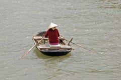 Vietnamese woman rowing Royalty Free Stock Photo