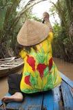 Vietnamese woman rows a boat, Mekong River Stock Photos
