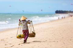 Vietnamese woman selling Fruits at Mui Ne beach. Vietnam Stock Photography
