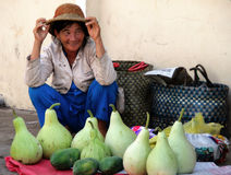 Vietnamese woman selling vegetables in the market Stock Photos