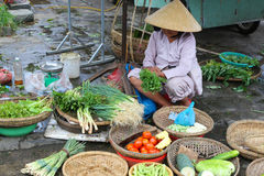 Vietnamese woman sells vegetables on the streets Stock Images