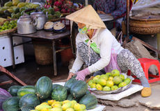 Vietnamese woman sells vegetables on the streets Royalty Free Stock Photos
