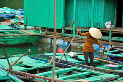 A Vietnamese woman standing on Bamboo boat Royalty Free Stock Image