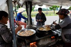Vietnamese woman street food vendor Royalty Free Stock Photo