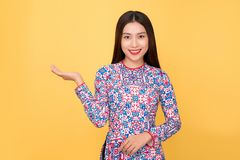 Vietnamese woman traditional festival costume Ao Dai. Tet holida Stock Photography