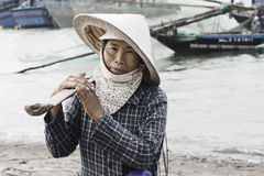 Vietnamese woman wearing traditional conical hat Stock Photo