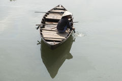 Vietnamese woman on wooden boat. Hoian Vietnam. Vietnamese woman sitting on a wooden boat. Hoian, Vietnam Stock Photos