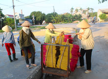 Vietnamese women collect the incense sticks after drying Stock Photos