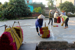 Vietnamese women collect the incense sticks after drying Royalty Free Stock Photo