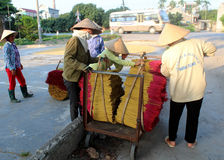 Vietnamese women collect the incense sticks after drying Royalty Free Stock Photos