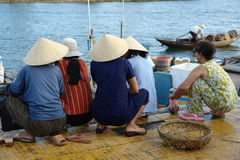 Vietnamese women at harbor. Vietnamese women helping their husbands with the work in the harbor Royalty Free Stock Photos