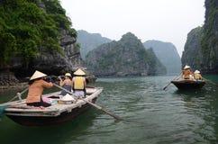 Vietnamese women on paddle boats Stock Photography