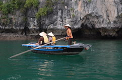 Vietnamese women on paddle boats Royalty Free Stock Photography