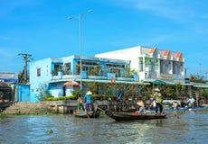 Vietnamese women rowing the boats in Mekong Delta, Vietnam Stock Photo