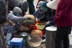Vietnamese women selling fish at the outskirts of Da Nang Stock Photo
