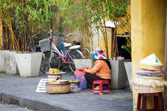 Vietnamese women selling food on the street of Hoi An Stock Photo