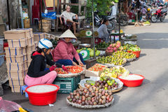 Vietnamese women are selling fruits at the wet market. NHA TRANG, VIETNAM - DECEMBER 18: Vietnamese women are selling fruits at the wet market on December 18 Royalty Free Stock Images