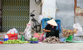 Vietnamese women selling many tropical fruits Royalty Free Stock Photo