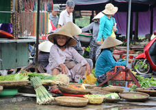 Vietnamese women sells vegetables on the streets Royalty Free Stock Photography