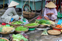 Vietnamese women sells vegetables on the streets Royalty Free Stock Photos