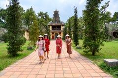 Vietnamese women strolling in garden of Thien Mu Pagoda, Hue City, Vietnam