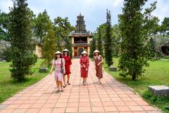 Free Vietnamese Women Strolling In Garden Of Thien Mu Pagoda, Hue City, Vietnam Stock Images - 207129554