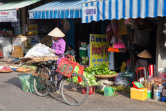 Vietnamese women in traditional conical hat at the wet market. NHA TRANG, VIETNAM - DECEMBER 18: Vietnamese women in traditional conical hat at the wet market on Stock Photography
