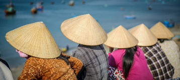 Vietnamese women waiting for fishing boats 3 Royalty Free Stock Image