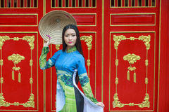 Vietnamese women wear Ao dai and non la. Vietnamese woman wear . Ao dai is famous traditional custume for woman in Vietnam Royalty Free Stock Photos