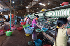 Vietnamese women working in silk factory. Dalat. Vietnam Stock Images