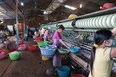 Vietnamese women working in silk factory. Dalat. Vietnam Stock Images