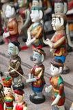 Vietnamese Wooden Carvings. Painted wood carving of Vietnamese characters in Hanoi Vietnam Royalty Free Stock Photos