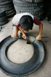 Vietnamese worker,  recycle tire, tyre Stock Photo