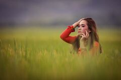 Vietnamese young beautiful brunette posing in a red dress Royalty Free Stock Images