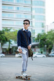Vietnamese young man on skateboard Royalty Free Stock Photos