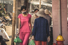 Vietnamese young woman in the market Royalty Free Stock Photo