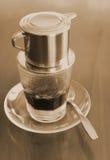 Vietnamesischer Kaffee im Sepiaton Stockfotos